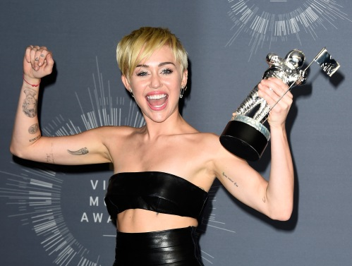 INGLEWOOD, CA - AUGUST 24: Recording artist Miley Cyrus poses in the press room during the 2014 MTV Video Music Awards at The Forum on August 24, 2014 in Inglewood, California. (Photo by Frazer Harrison/Getty Images)